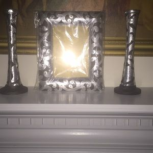 Unusual picture frame and candleholders